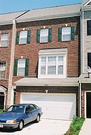 Luxurious 4-Level, 3 BR, 3.5 BA Townhouse with Lots of Light